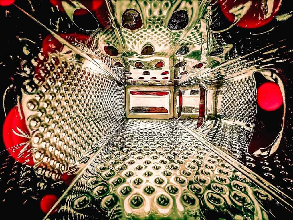 The inside of a cheese grater, taken in my garden with my phone, with two Lightroom presets applied.